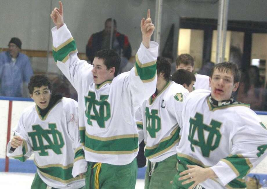 Photo by Russ McCreven Notre Dame-West Haven hockey players celebrate moments after the Green Knights' 5-0 victory over Glastonbury in the CIAC Division I championship game at Ingalls Rink in New Haven.