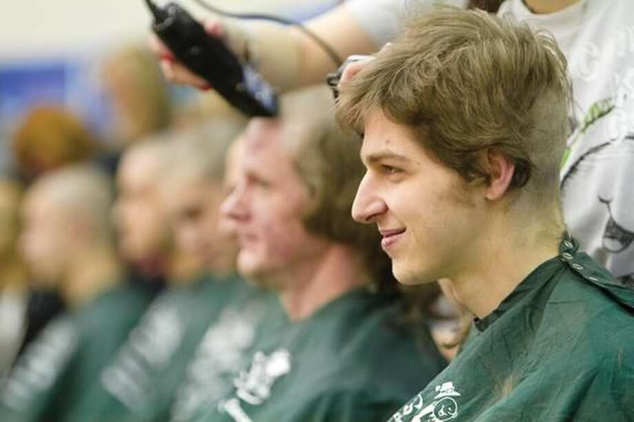 Submitted Photo Quinnipiac University student Kevin Carroll volunteered to have his head shaved March 6 during the university's third annual St. Baldrick's Day.