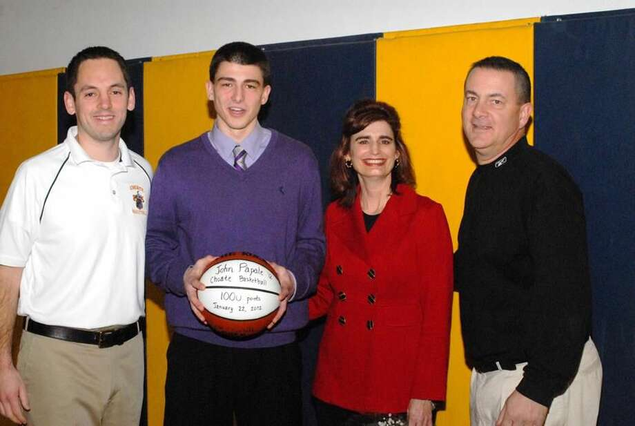 Photo by Bill O'Brien Choate senior John Papale, of Wallingford, was honored before a recent game against Cheshire Academy. Papale, pictured with coach Adam Finklestein and parents Joan and Mike, is the school's all-time leading scorer with 1,153 points. He will attend Boston University in the fall.