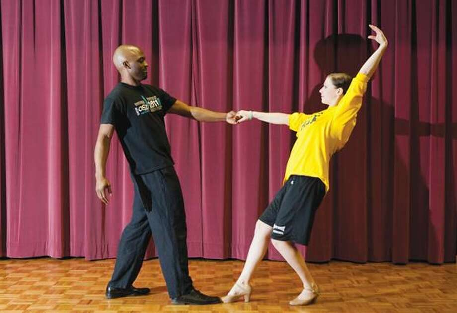 "Submitted Photo Mohammed Bey and Catherine Makuch rehearse for ""Dancing with the QU Stars"" in Buckman Theater during spring break."