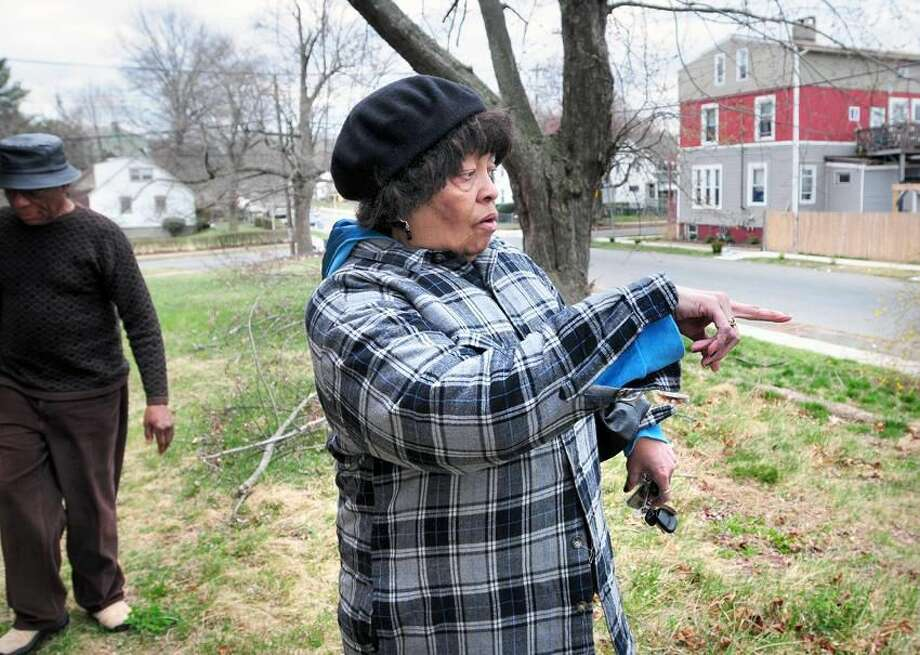 Orlander Highsmith, left, and Carolyn Smith, right, point out trash dumped on the former Hamden Community Center property on Morse Street in Hamden. Photo by Arnold Gold/Register
