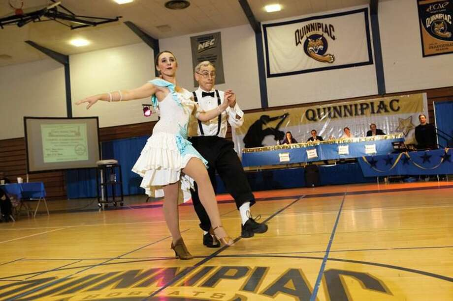 """Submitted Photo Quinnipiac University student Danielle Martin, left, dances with her partner Stan Rothman, a professor of mathematics at Quinnipiac during the """"Dancing with the QU Stars"""" event."""