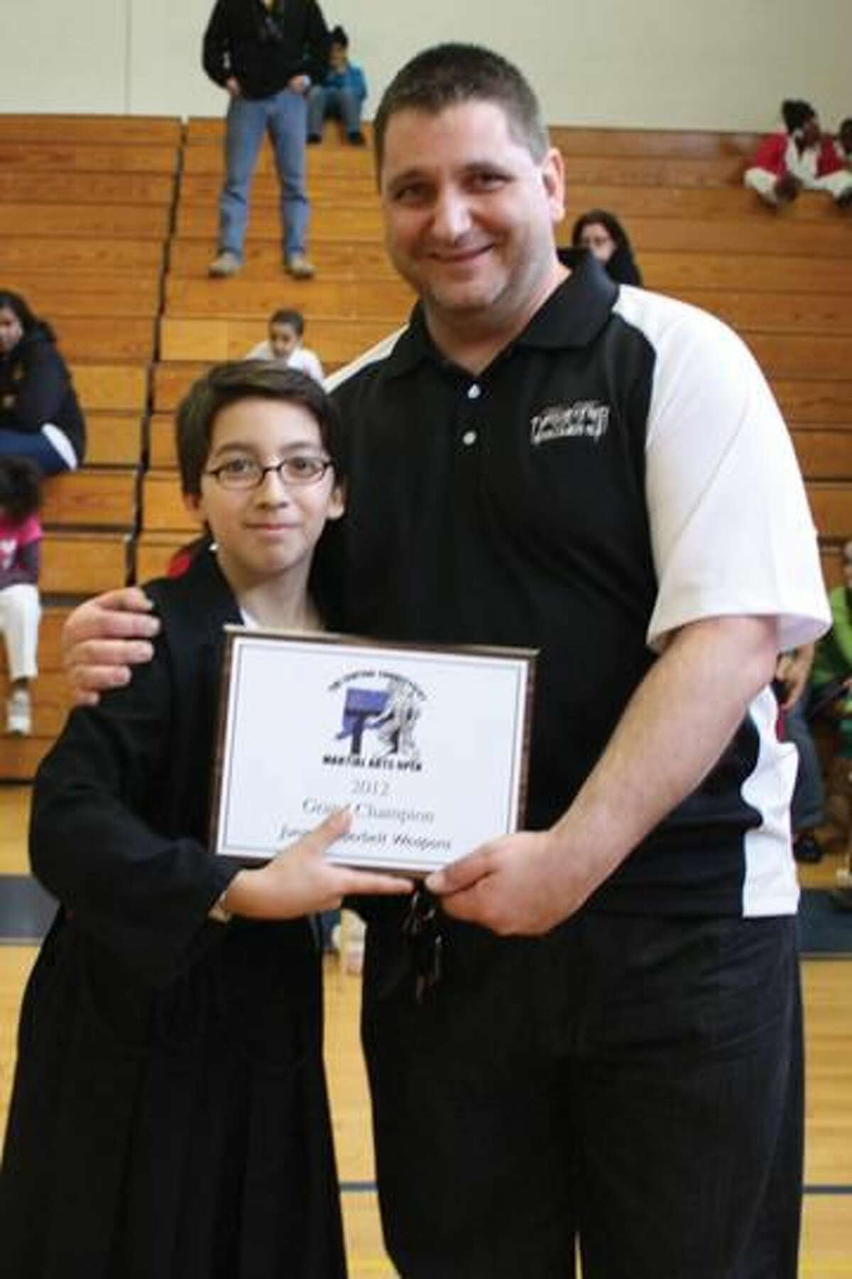 Submitted Photo North Haven local, Nico Rivera, recently won the Under Black Belt Weapons Grand Championship at The Central Connecticut Martial Arts Open.