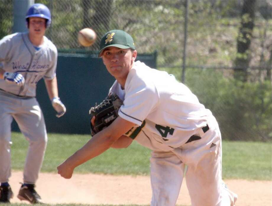 Photo by Russ McCreven Hamden's Tyler Mitchell delivers a pitch in last week's loss to West Haven.