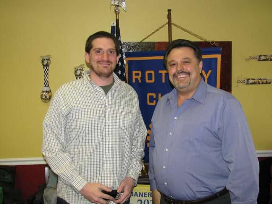 Submitted photo courtesy of David Marchesseault, Rotary PR Chairman Bryan Nurnberger, left, poses with Rotary President Guy Casella at the Breakfast Nook after describing his mission to serve the desperately poor.