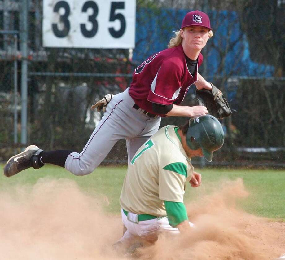 Photo by Russ McCreven North Haven second baseman Johnny Johnson turns a double play during the Indians' 15-5 loss to top-ranked Notre Dame Monday afternoon at Quigley Stadium in West Haven.