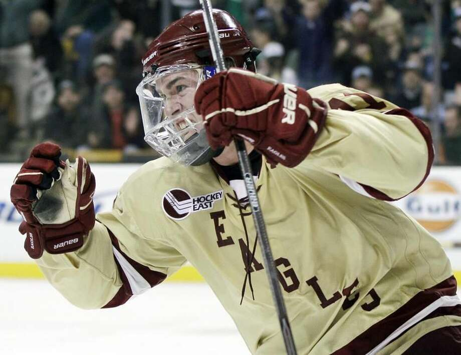 Boston College's Pat Mullane, celebrates his goal against Maine in the second period of an NCAA college Hockey East final in Boston, Saturday, March 17, 2012. (AP Photo/Elise Amendola)