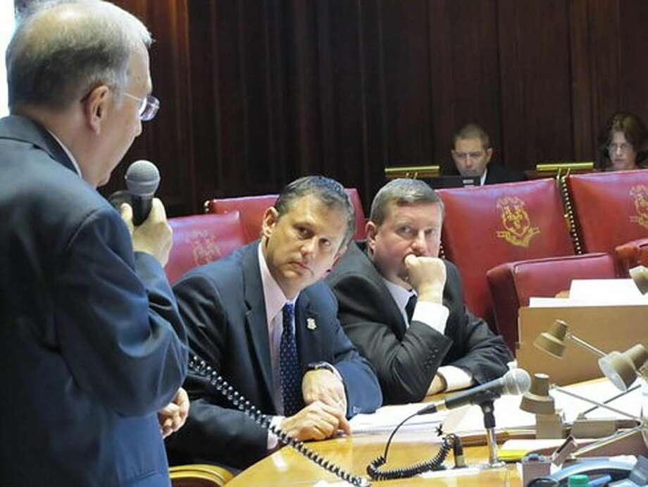 Sens. Kevin Witkos and John Kissel watch Sen. Martin Looney speak. Hugh McQuaid Photo/ctnewsjunkie.com