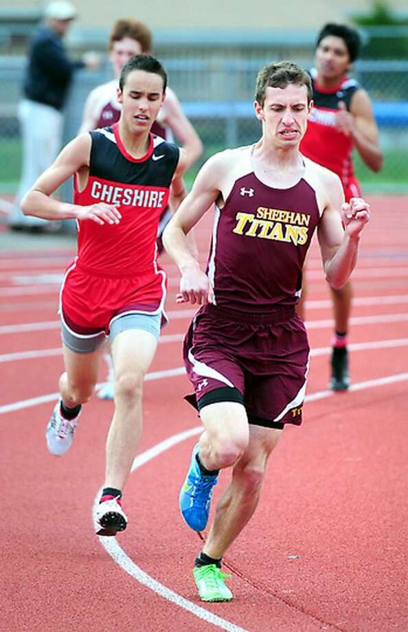 Tommy Lupoli (right) of Sheehan leads in the final lap of the 1600 meter run with Trey Phillips (left) of Cheshire close behind in a meet at Cheshire on 4/24/2012. Photo by Arnold Gold/New Haven Register