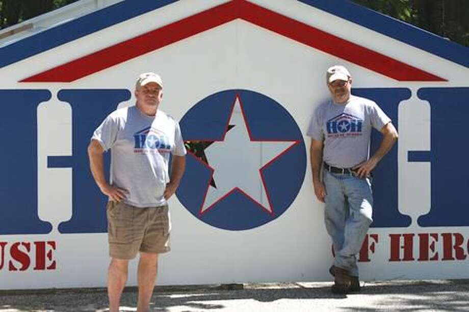 Submitted Photo by Carol May Bill May, left, and Steve Cavanaugh in front of House of Heroes float for Hamden Memorial Day Parade.