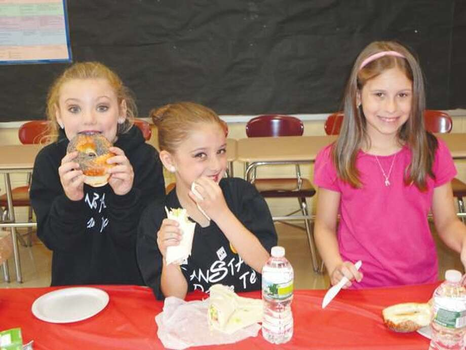 Photo courtesy of David Marchesseault, Rotary PR Chairman North Haven's (L-R) Mya Yeller, Juliana Rubino and LiLiana Falcone paused for a bite before going on to perform their award winning dance routines in the annual Kids for Kids dance competition.