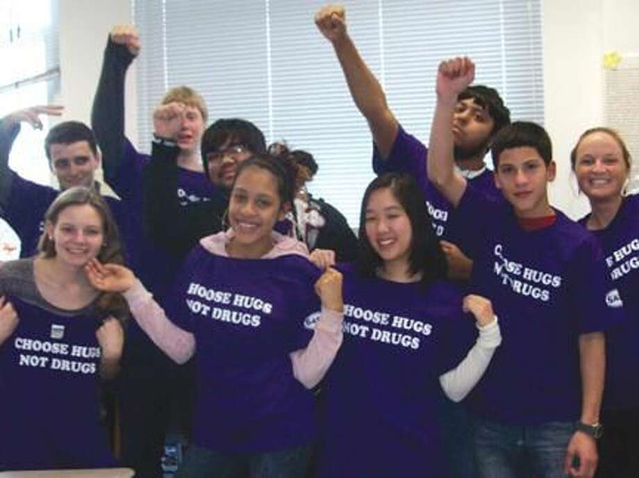 "Submitted Photo Hamden SADD member's proudly wearing their ""Choose Hugs, Not Drugs"" t-shirts."