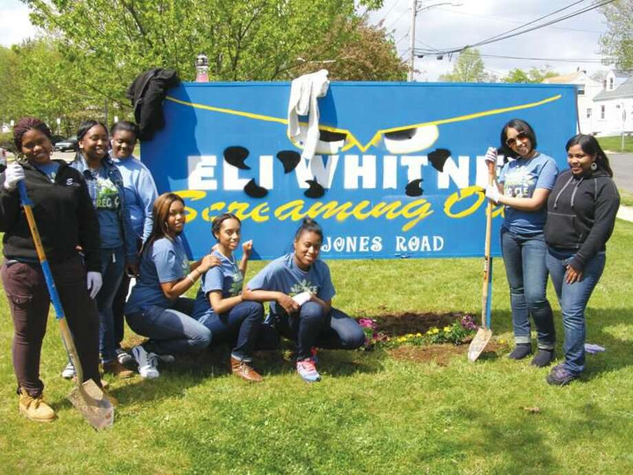 Submitted Photo Senior Young Women at Eli Whitney High School celebrated Earth Day April 24 by cleaning-up the campus and planting flowers. Pictured left to right: Cierra Smith, Armani Pearson-Emery, Briana Harrington, Airess Walker, Cecily Flint, Taylor McNeal, Amarelys Aponte, and Danica Jackson.