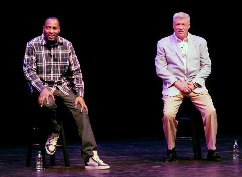 New York Giants receiver Hakeem Nicks (left) and offensive coordinator Kevin Gilbride (right) answer questions at Southern Connecticut State University in New Haven. Photo by Arnold Gold/New Haven Register
