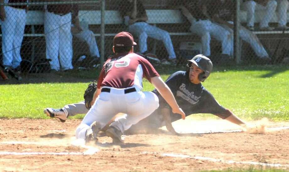 Photo by Dave Phillips North Haven pitcher Nick Nieves tags out Branford's Tyler Forgione at the plate during Sunday's game.