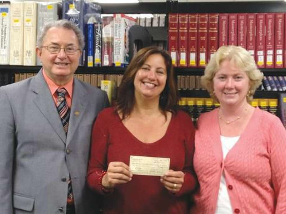 Submitted Photo by Susan Swirsky, GCC Administrative Assistant Theresa Ranciato-Viele (center) presents Rotary Foundation check for two $1000 scholarships for North Haven residents at Gateway Community College to Deans Wilson Luna (left) and Mary Ellen Cody (right).