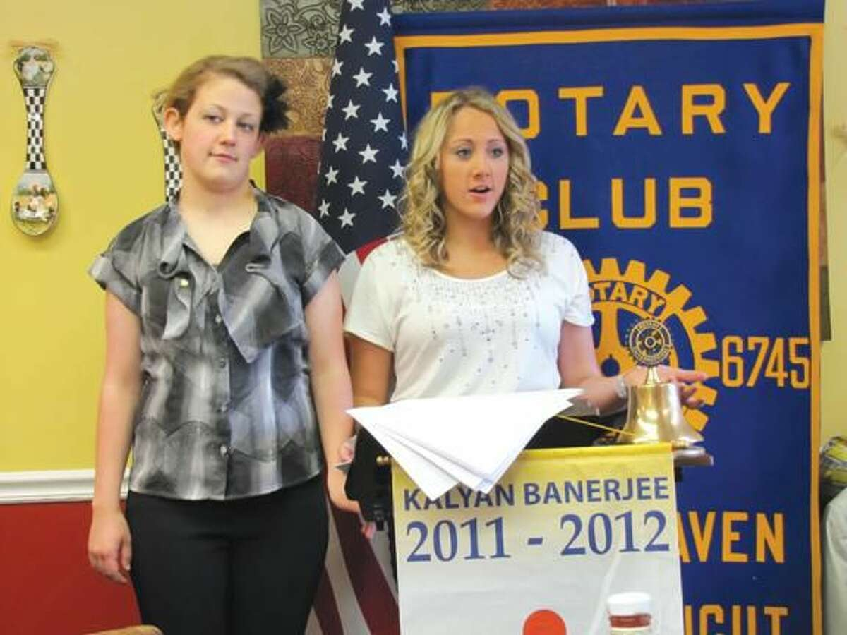 Submitted photo by David Marchesseault, Rotary PR Chairman Alex Johnson and Felishia LaPointe, co-presidents of the North Haven High School Interact Club, deliver their annual report to the Rotary Club.