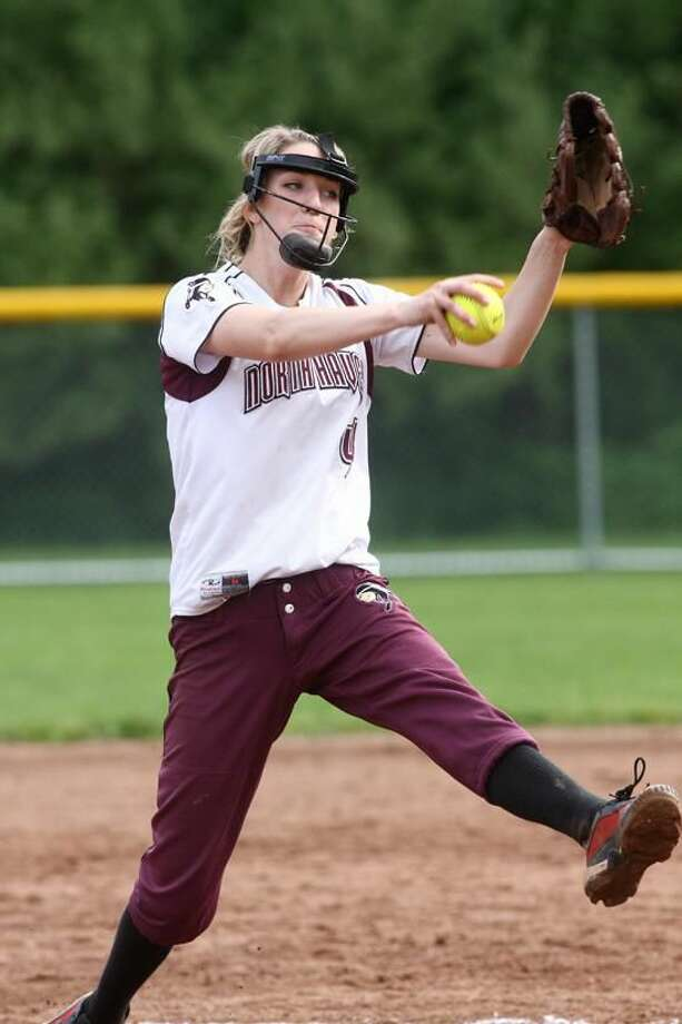 Photo by Russ McCreven North Haven's Arianna Pustari delivers a pitch during a recent SCC tournament game against Foran.
