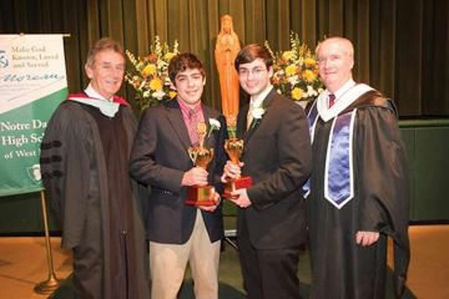 Submitted Photo Left to right, Notre Dame President Brother James Branigan, salutatorian Bryan Bystrianyk, valedictorian Christopher Carchia, and Principal Patrick Clifford pose for a picture following Honors Night on May 17.