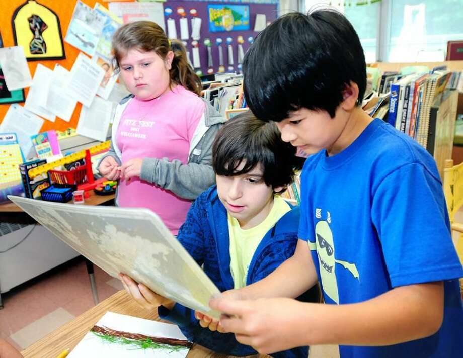 From left, Allison Marino, 9, Jackson Tubis, 11, and Evan O'Conell, 8, work on end of the year projects at Ridge Road Elementary School in North Haven. Photo by Arnold Gold/New Haven Register
