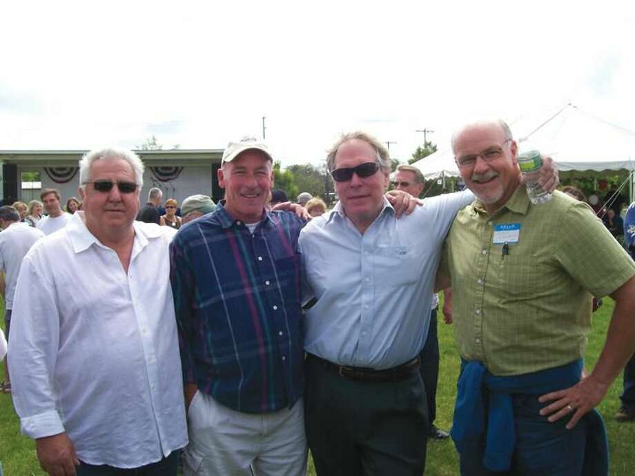Photo by Lynn Fredricksen North Haven High School graduates, left to right, Dave Rosadini (1968), Gerry Griffin (1968), Wayne Cutler (1966), and Chris Griffin (1977) welcomed the opportunity to get reacquainted during the North Haven High School All-Class Reunion on June 2.