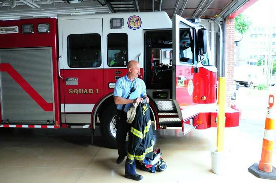 Lt. Gary Merwede unloads his turnout gear at the renovated fire station at Memorial Town Hall in Hamden on 6/18/2012. Photo by Arnold Gold/New Haven Register