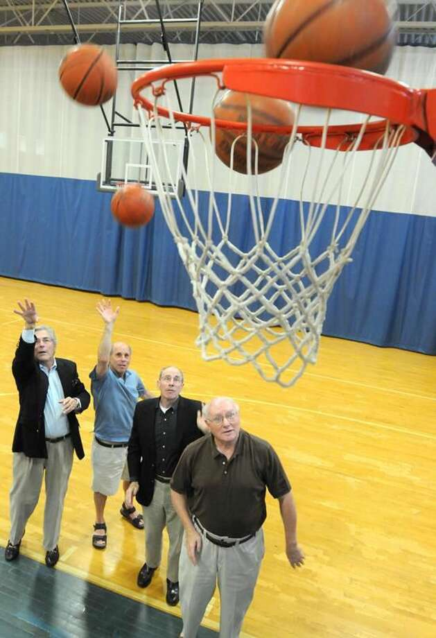 """JCC basketball legends,left to right: David Beckerman, Jimmy Wolf, Mark Sklarz and Art """"Red"""" Klineberg, at the Jewish Community Center of New Haven."""