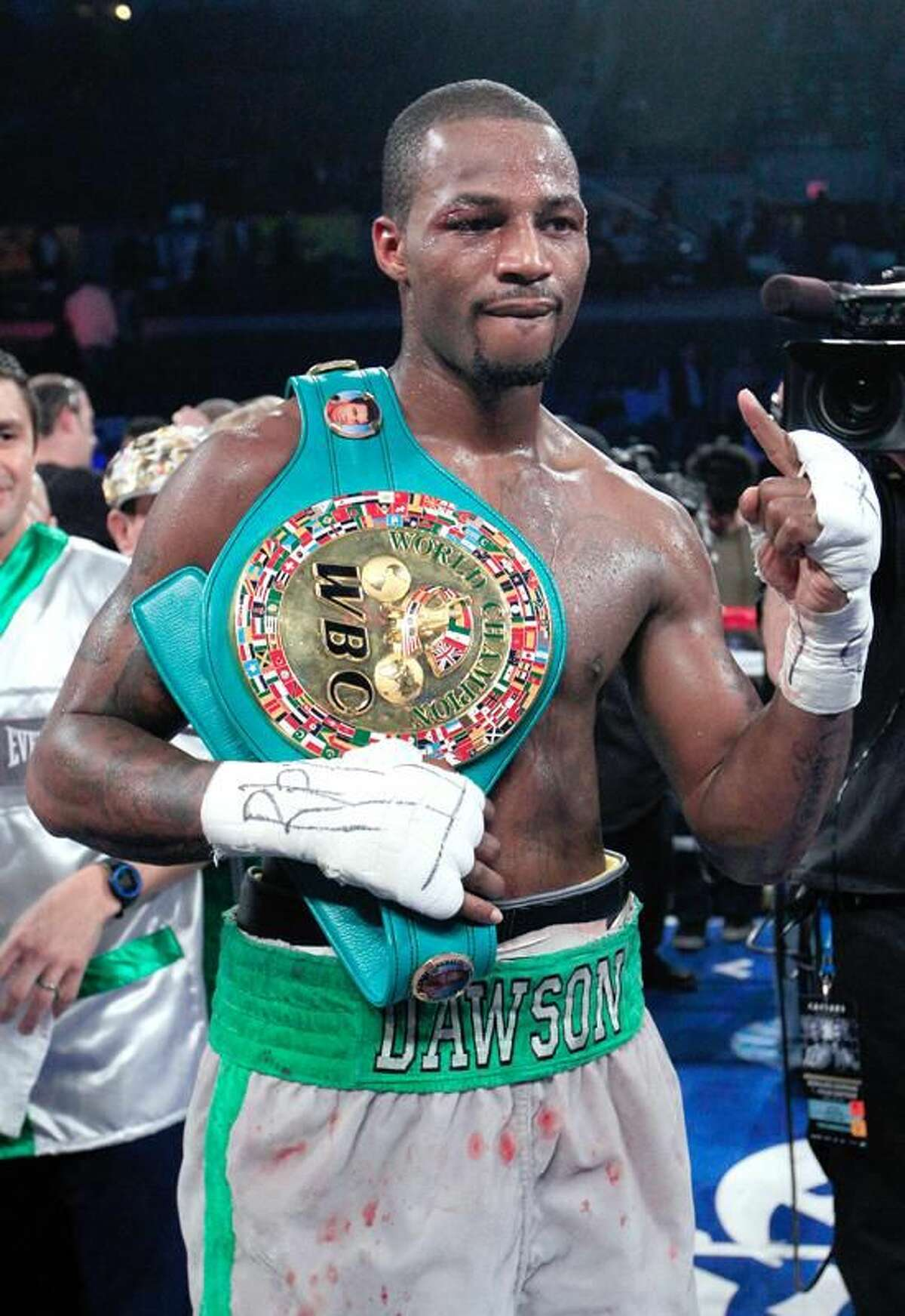 Chad Dawson holds one finger up as he poses with a championship belt after defeating Bernard Hopkins in their light heavyweight boxing match against in Atlantic City, N.J., Saturday, April 28, 2012. Dawson won a majority decision. (AP Photo/Mel Evans)