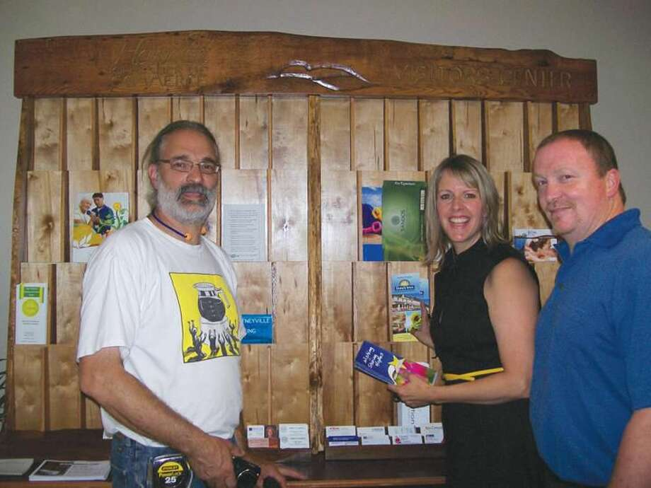 Photo by Lynn Fredricksen Hamden Chamber of Commerce President Nancy Dudchik is flanked by Chamber members Jim Brewster of Your Castle Carpenter, LLC (right) and Joe DeRisi of Urbanminers, LLC. Brewster and DeRisi collaborated to create the handcrafted display case (background) at the new Hamden Chamber's new Visitor & Resource Center, 2969 Whitney Ave. This center will serve as an informational hub showcasing Hamden's businesses, historical sites and tourist attractions for our members, public, and visitors to Hamden.