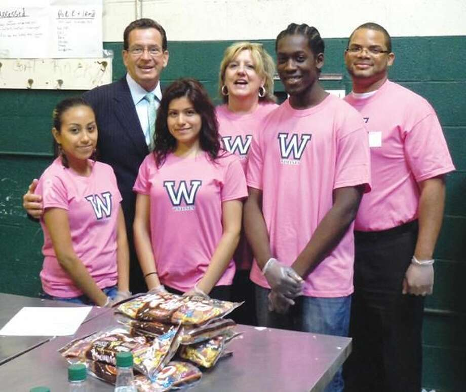 Submitted Photo Governor Malloy poses with Gabriella Cuapio, Terrell Jones and Yessica Perez along with Hairdressing Department Head and Advisor Karen Etheridge and Drafting Instructor Jonathan Encarnacion.