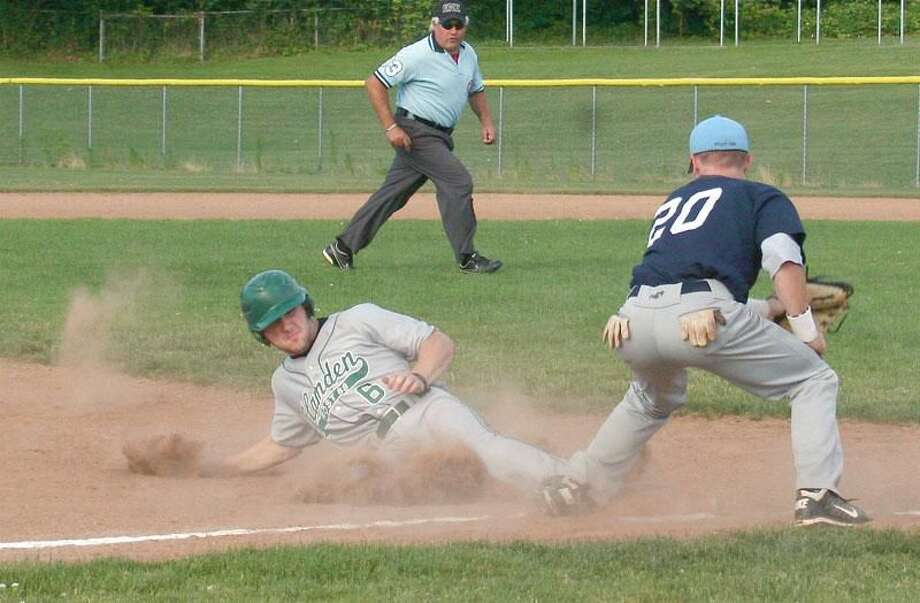 Photo by Russ McCreven Hamden's Brandon Dadio slides safely into third as Milford's Ed Michaud takes the throw during Tuesday night's game. Milford won 5-0.