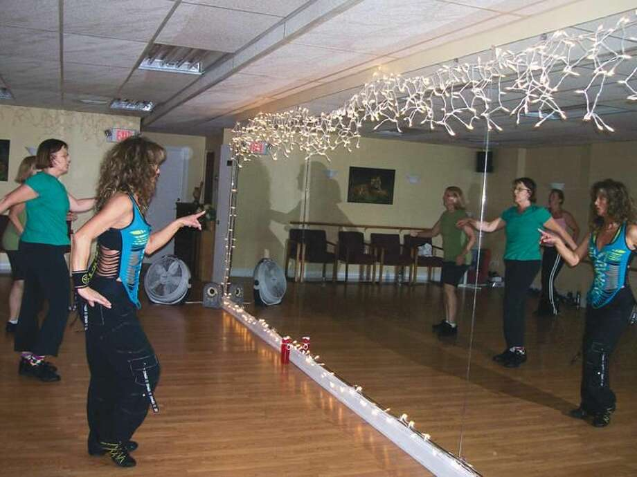 Photo by Lynn Fredricksen Fitness instructor Nancy Ryan leads a class at her new studio, Moving Forward Fitness at 1220 Whitney Avenue in Hamden. For details on classes, stop by the studio.