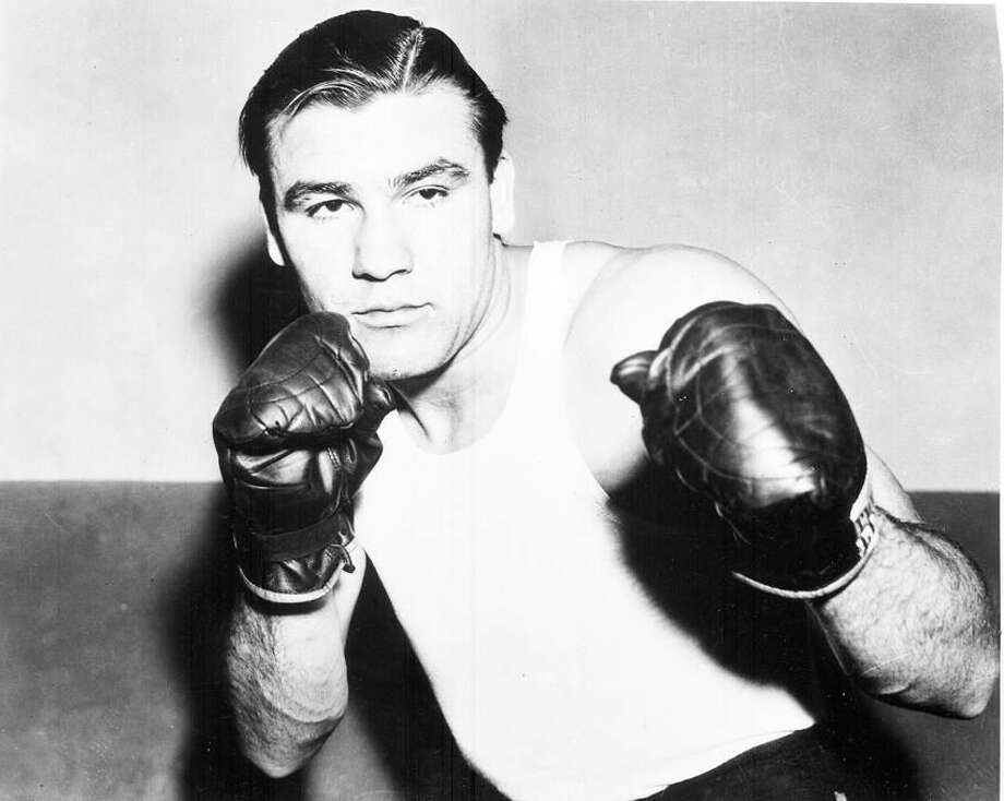 American boxer Nathan Mann, at an unknown location, in 1937. (AP Photo)