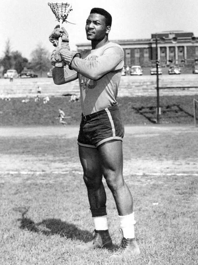 Jim Brown is shown playing in his last college game for Syracuse University in this 1957 handout from Syracuse University. Brown starred as the Orange defeated archrival Army 8-6 to finish the season unbeaten. Brown is regarded by many as the greatest lacrosse player and the greatest running back in football. (AP Photo/Syracuse University Handout)