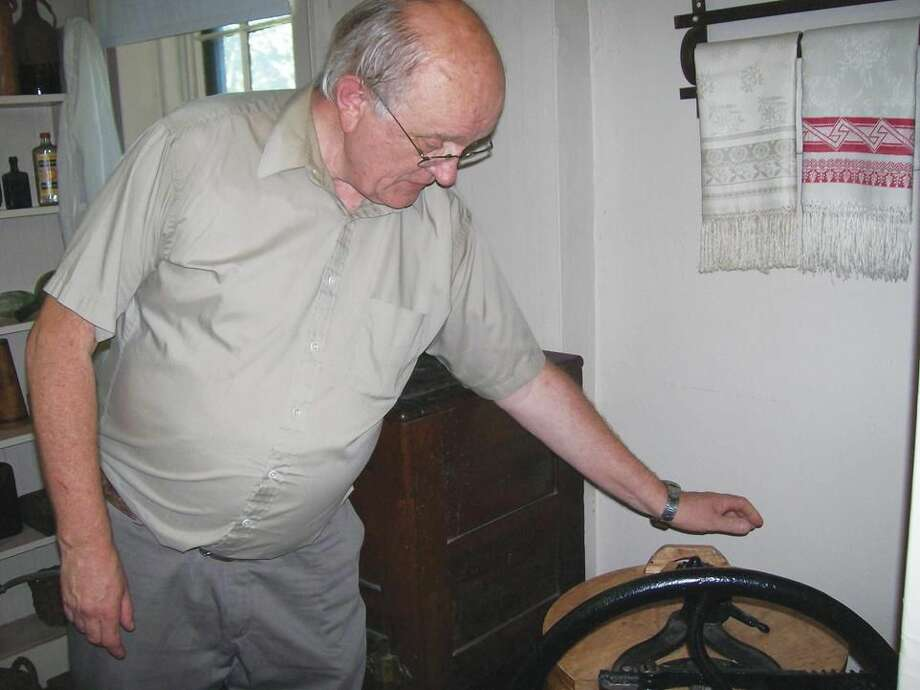 Bob Iverson, president of the North Haven Historical Society, explains the features of a very early washing machine on display at the Martha Culver House on Quinnipiac Avenue. The house was open for tours on Sunday as part of an open house event presented by the Historical Society.