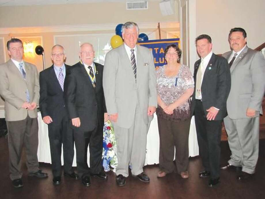 Photo courtesy of David Marchesseault, Rotary PR Chairman The 2012-2013 officers of the North Haven Rotary Club are (L-R): Brendan McCaffery (Secretary), John Costanzo (Sgt. at Arms), William Espowood (Treasurer), Nicholas D'Ambrosia (Vice President), Debbie Volain (President- Elect), Michael Hallahan (President), and Gaetano Casella (Past President).