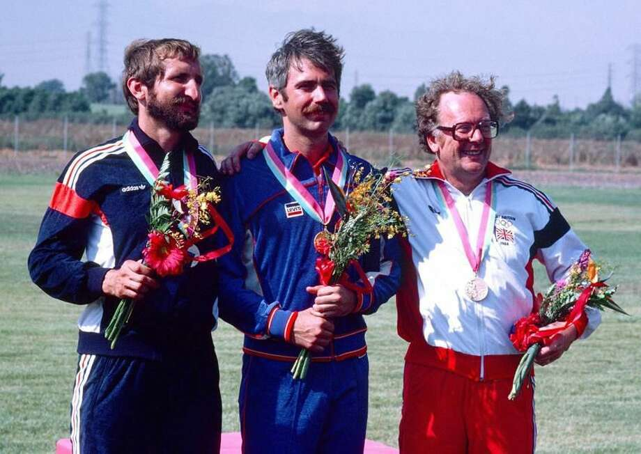 Army Captain Edward F. Etzel, center, from North Haven, stands with the silver and bronze medalists after receiving a gold medal in the small-bore rifle English competition at the 1984 Summer Olympics in Los Angeles. He scored 599 points out of a possible 600. (Photo courtesy of Department of Defense)