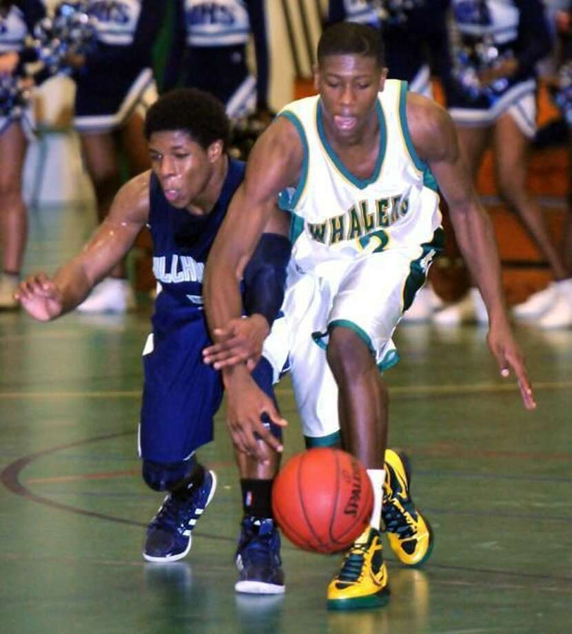 New London's Kris Dunn, right, battles for the ball with Hillhouse's Andre Anderson at 37th annual Doc Hurley Scholarship Basketball Classic at Weaver High in Hartford in December 2011. (Mara Lavitt/Register)