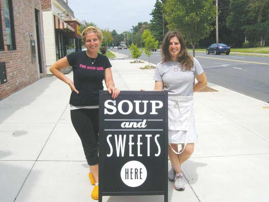 Photo by Lynn Fredricksen Siblings Jessica Hazan, left, and Erica O'Brien, right, stand by the sign advertising their businesses: The Soup Girl and Erica O'Brien Cake Design. Both are at 1242 Whitney Ave. in the Whitneyville section.