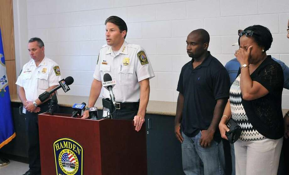 Hamden Police Chief Thomas J. Wydra speaks to the media about the shooting death of a Hamden man during a press conference at the Police Department. On the right is the victim's brother, Taikwon Dudley and his mother Pamela Heard. Peter Casolino/New Haven Register