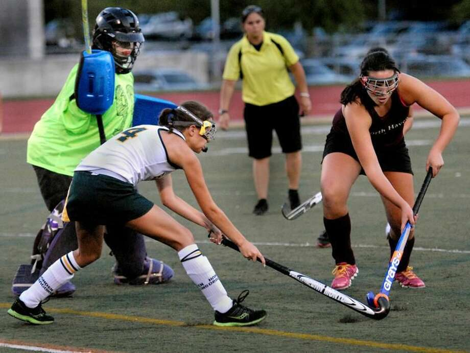 Hamden's Emily Tyler and North Haven's Carley Flannery fight for the ball near the North Haven goal during Hamden's 5-1 win Wednesday. Melanie Stengel/Register
