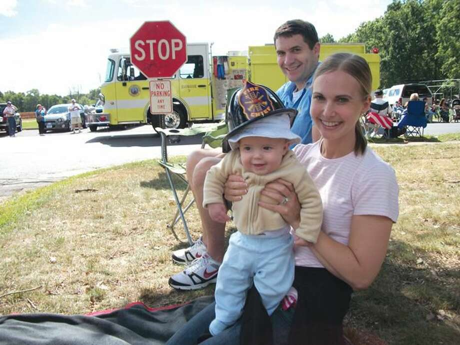 Alexander Smoot, 4 months, was perhaps the youngest fan to watch the firefighters parade on Sunday. He is pictured with his parents, Erica and Nicholas, all of North Haven.