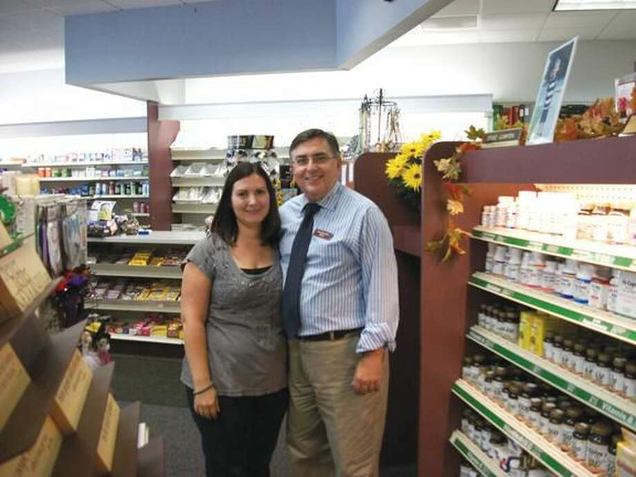 Photo by Lynn Fredricksen North Haven Pharmacy owner Gerald Acampora and his daughter, Stephanie Hryb share a father-daughter moment. The pharmacy, family owned and operated since the mid-1960s is located at 278 Maple Ave.