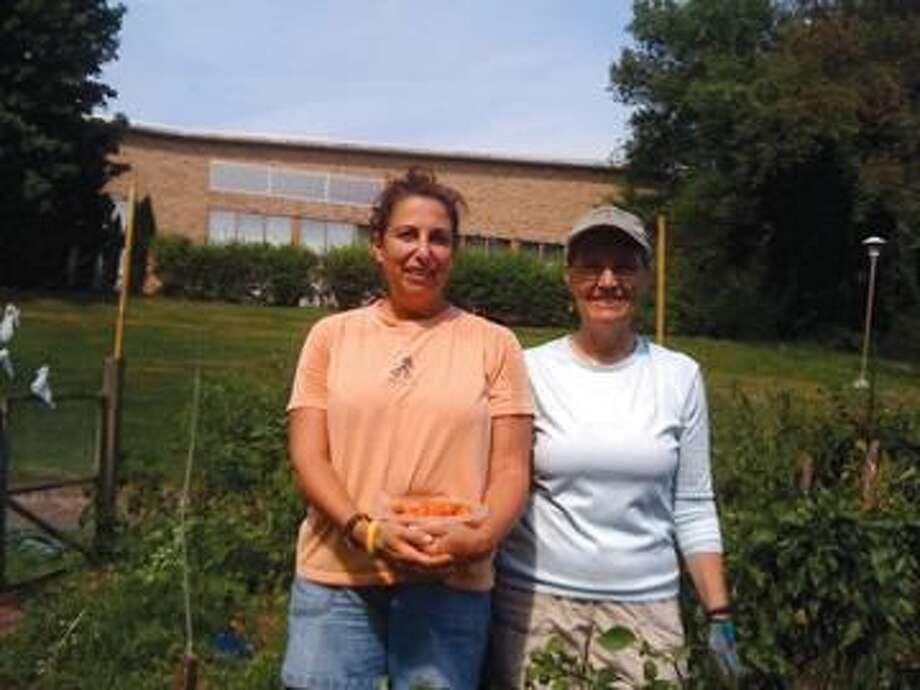 """Submitted Photo The photo shows Leslie Redmond and fellow congregant, Sue McDonald, who will tell you they """"love to get their hands dirty""""!"""