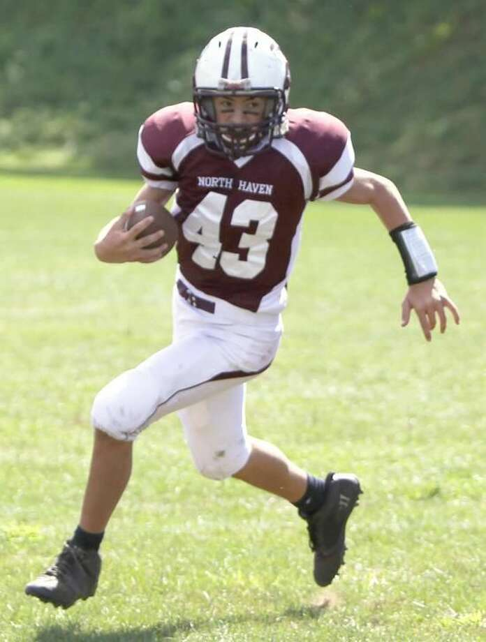 Photo courtesy of Gail Tantorski Kyle Mellilo runs with the ball for the North Haven eighth-grade team against North Branford.