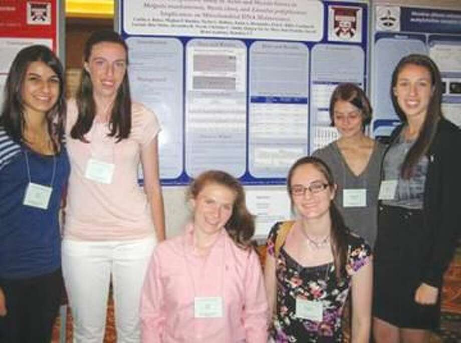 Submitted Photo Recent Sacred Heart graduates and students presented a poster at United Mitochrondrial Disease Foundation's Genomics and Mitochondrial Medicine Scientific Meeting in Bethesda. Pictured left to right: Rita Matta, '12 of Hamden; Caitlin Baker, '12 of Shelton; Erin Hillis, '12 of Derby; Christine Smith, '12 of Madison; Alex Novak, '13 of Shelton; and Meghan Buckley, '12 of North Haven.