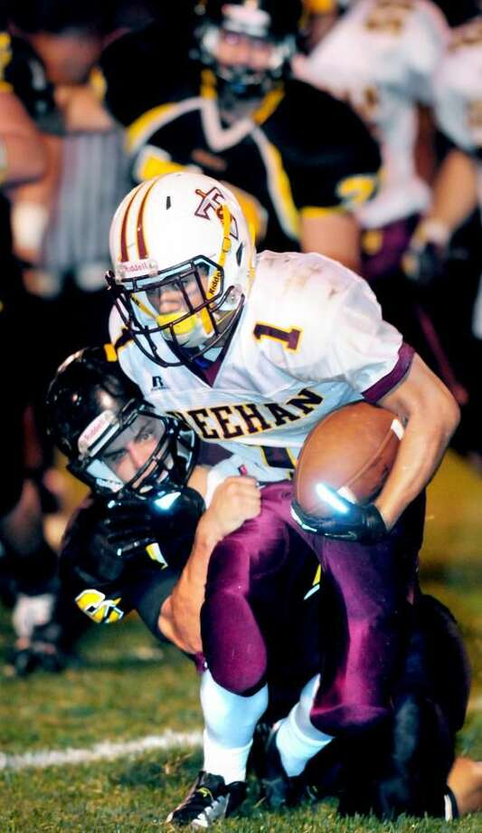 Jordan Laugeni (left) of Amity tackels Raphael Dominguez (right) of Sheehan in the first half on 9/21/2012. Photo by Arnold Gold/New Haven Register