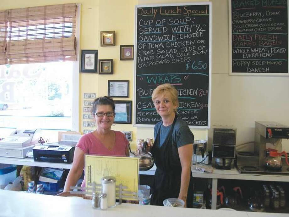 Photo by Lynn Fredricksen At The Sandwich Board, 2005 Whitney Avenue, new owner Debbie Douglas (left) works the lunch counter with server Mary Weaver.