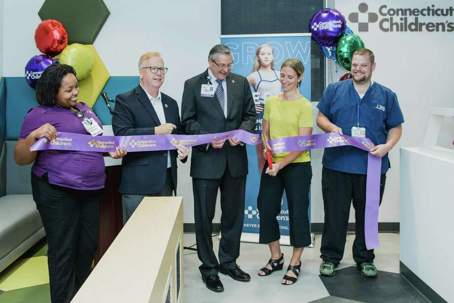 Danbury Mayor Mark Boughton (second from left) attends a September 2019 ribbon cutting for Connecticut Children's Medical Center's new clinic at 105-A Newtown Road in Danbury, Conn. Photo: Photo Via Twitter