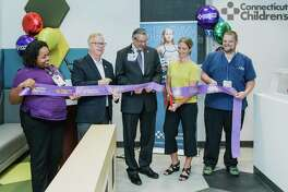 Danbury Mayor Mark Boughton (second from left) attends a September 2019 ribbon cutting for Connecticut Children's Medical Center's new clinic at 105-A Newtown Road in Danbury, Conn.